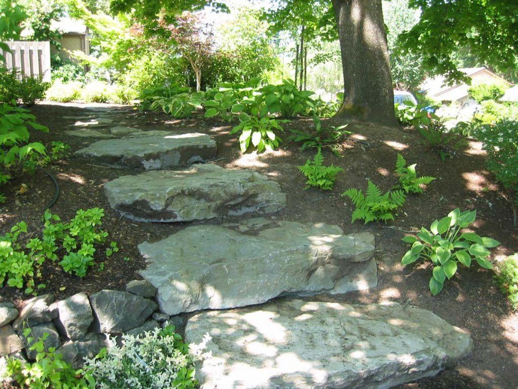 slab stone steps from driveway landscape design 3