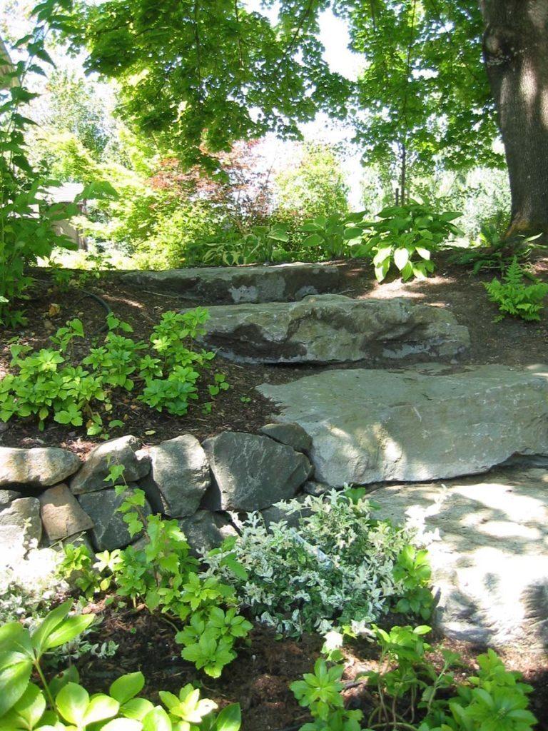 slab stone steps from driveway landscape design 2