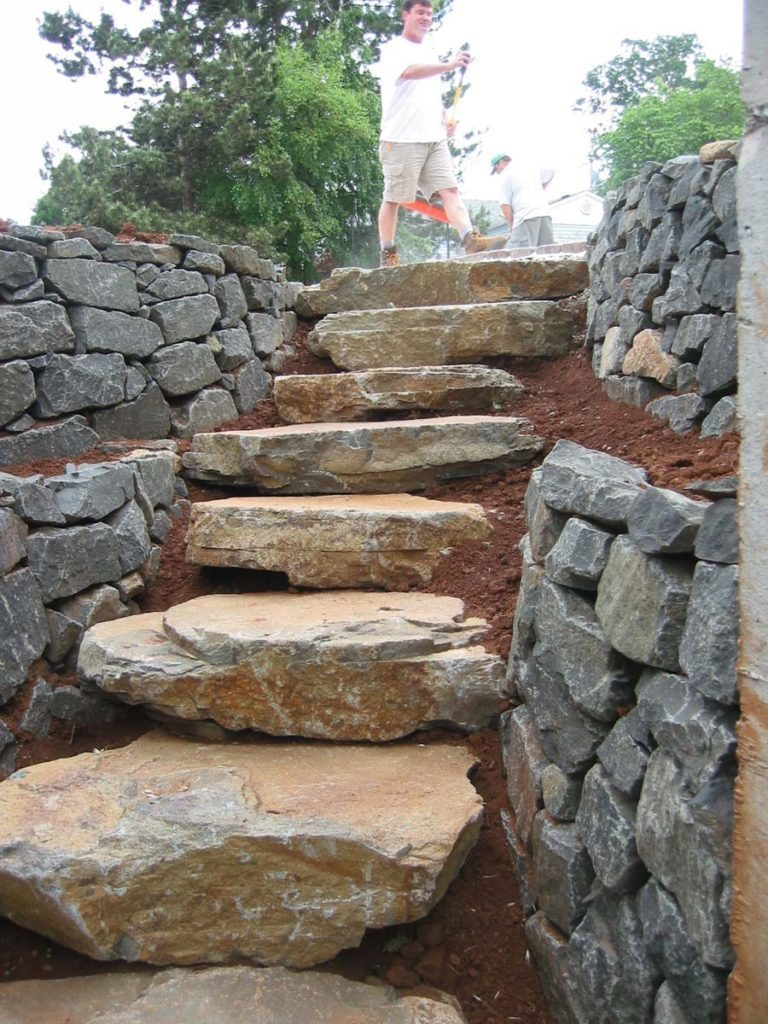 slab steps with rubble walls landscape design