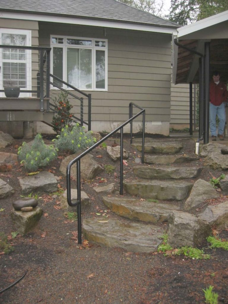 slab steps with rail landscape design