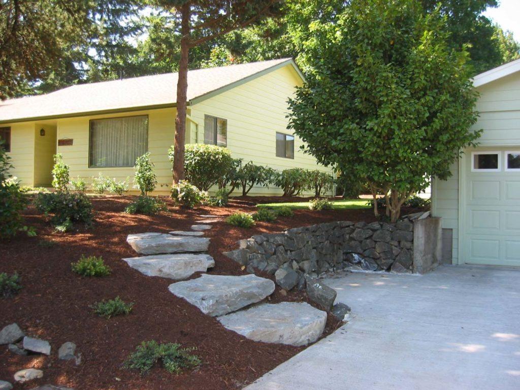 slab stone steps from driveway landscape design