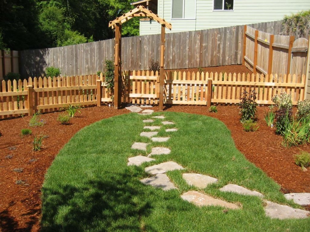 split stone path through lawn landscape