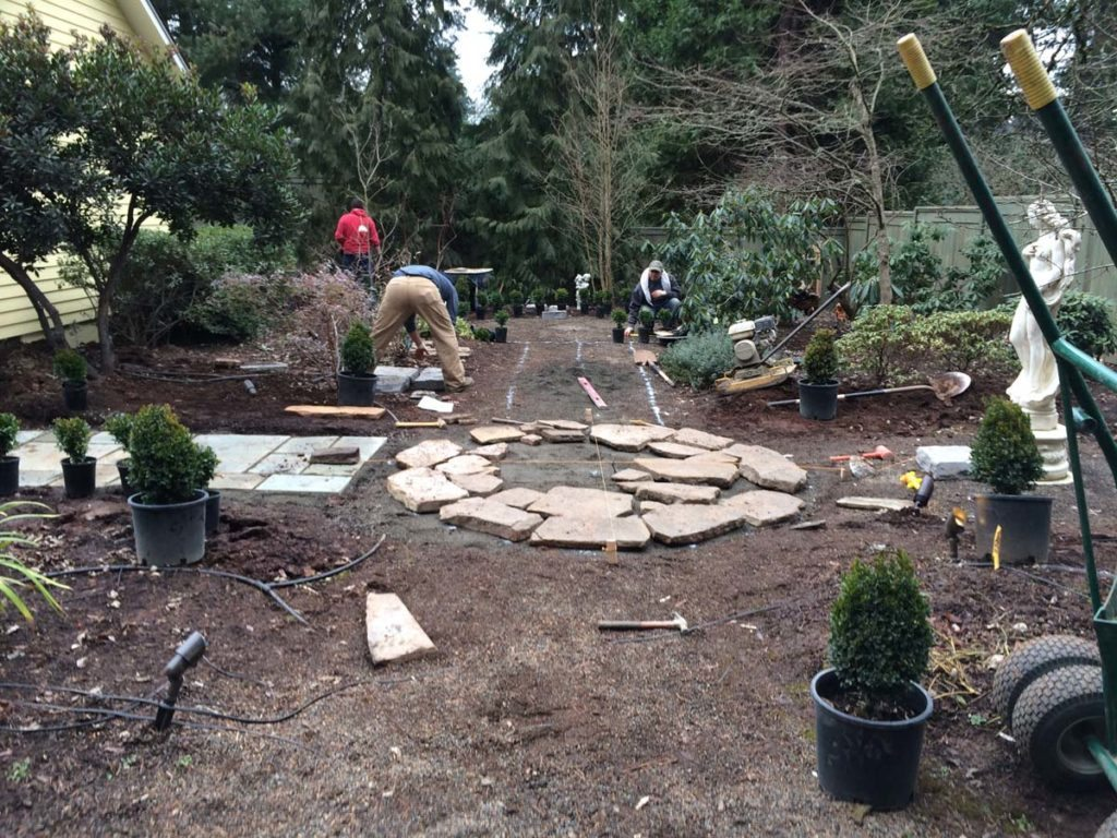 split stone patio construction in landscape design