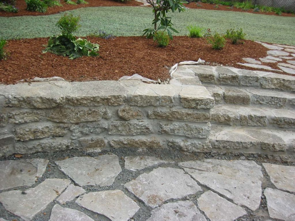 mortared stackstone wall and steps landscape design