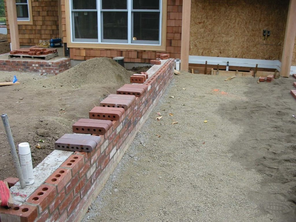 construction of seat walls with brick landscape design