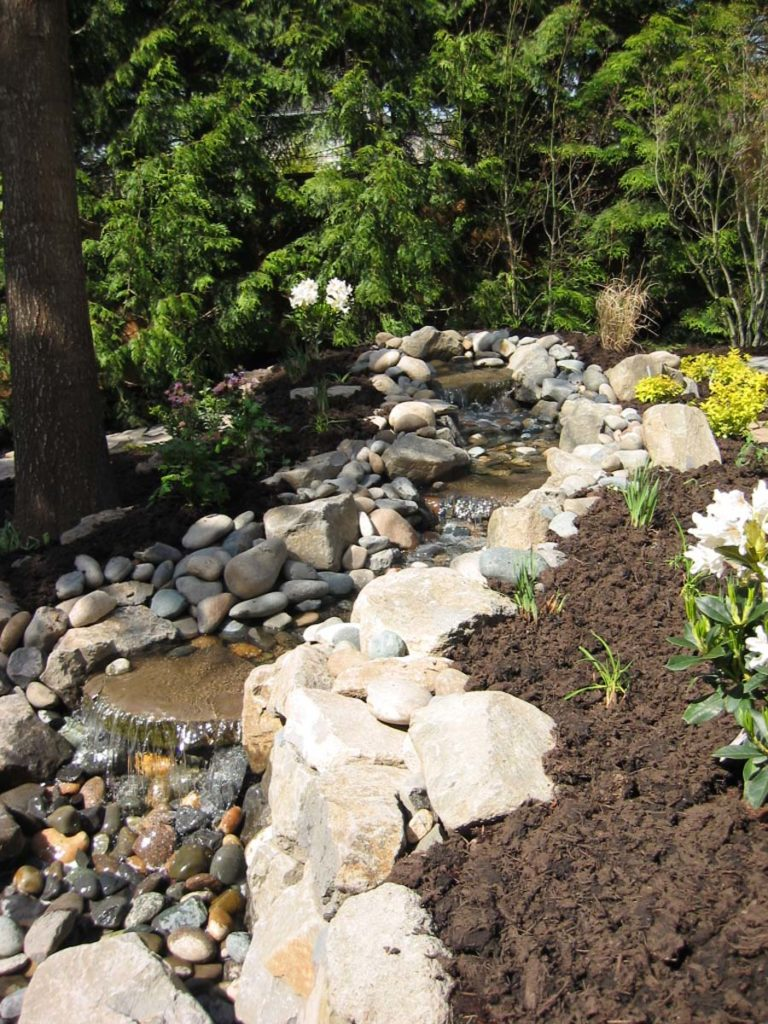 pond with waterfall and boulders landscape design 3