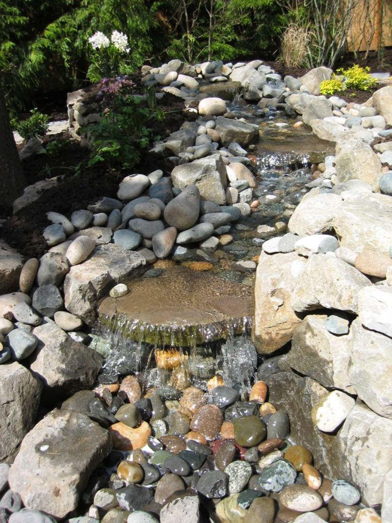 pond with waterfall and boulders landscape design 2