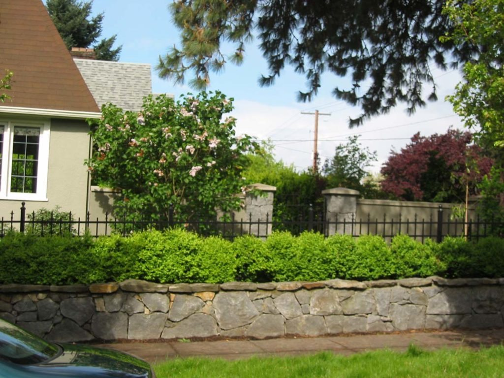 retaining wall and foliage in portland landscape design