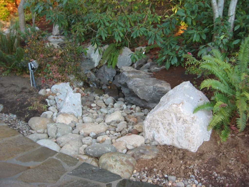 dry creekbed with boulders and split stone pathway in salem oregon