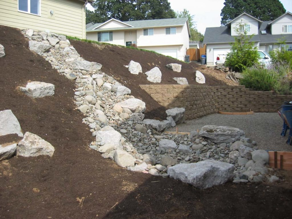 dry creekbed and boulder seeding on slope in salem oregon