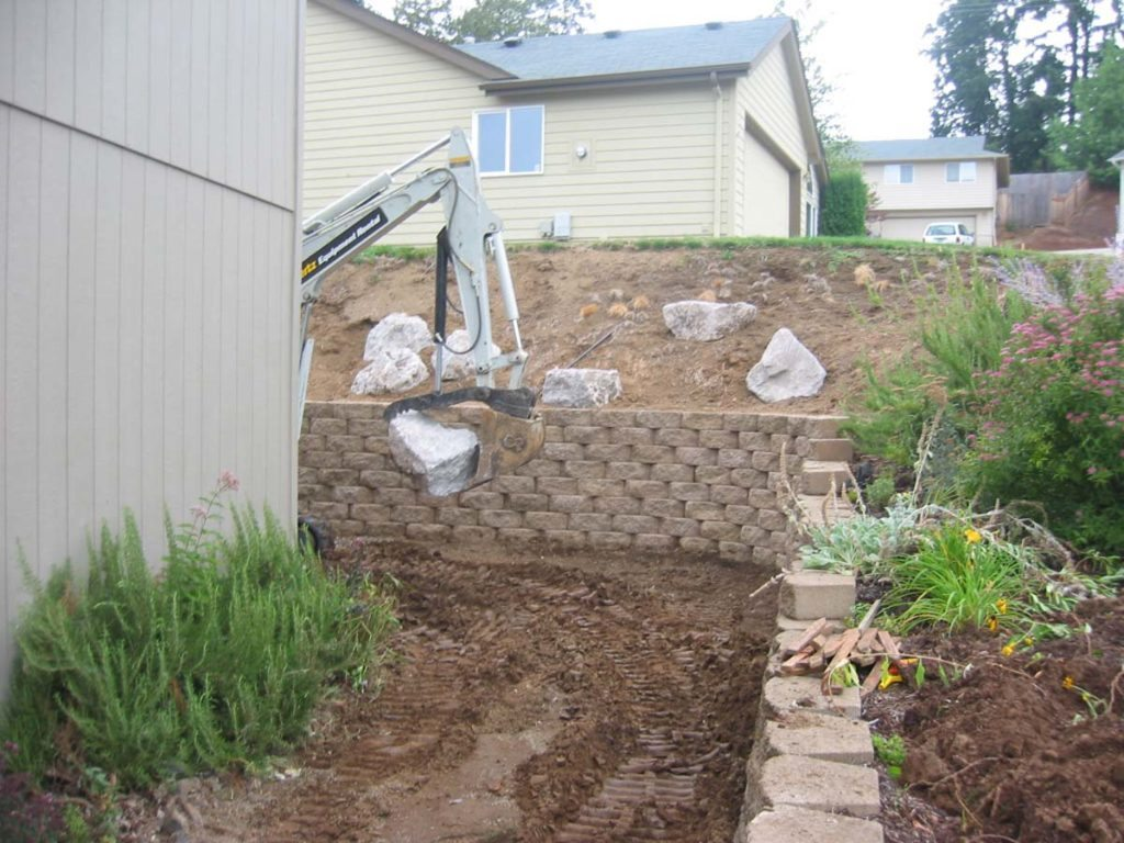 construction of retaining wall in landscape design