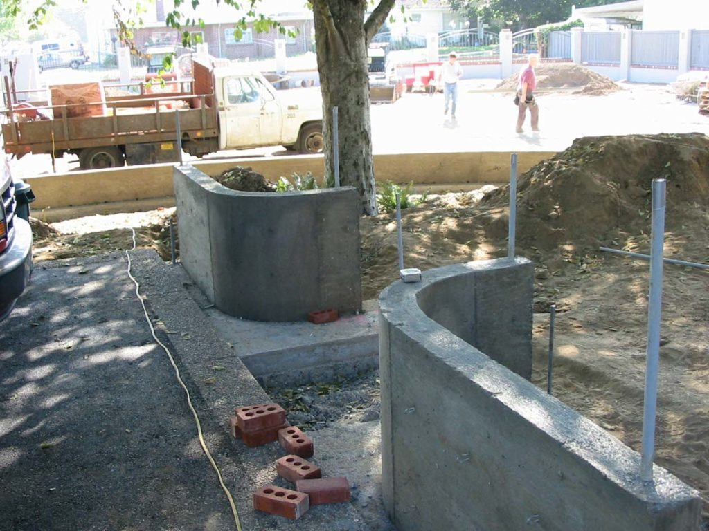 entry wall concrete construction before brick landscape design