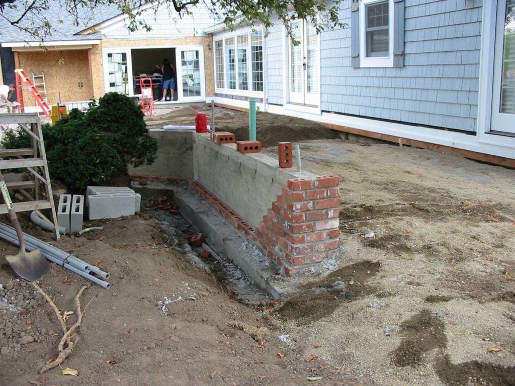entry wall concrete construction before brick landscape design 3