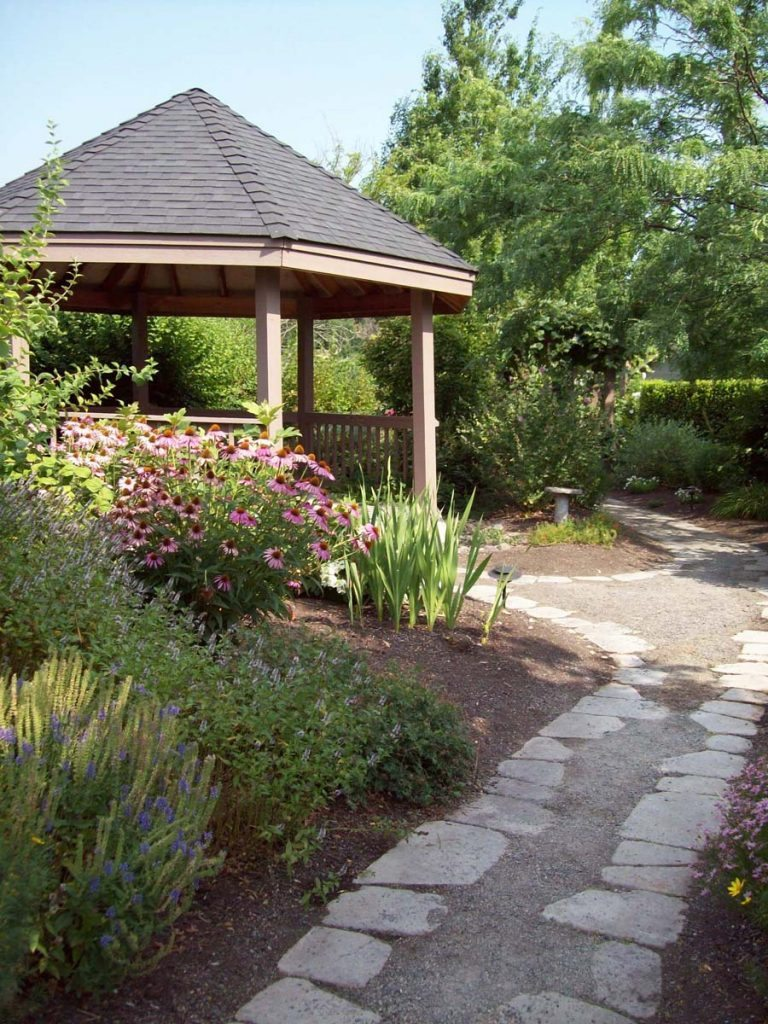 split stone gravel path in landscape design and gazebo