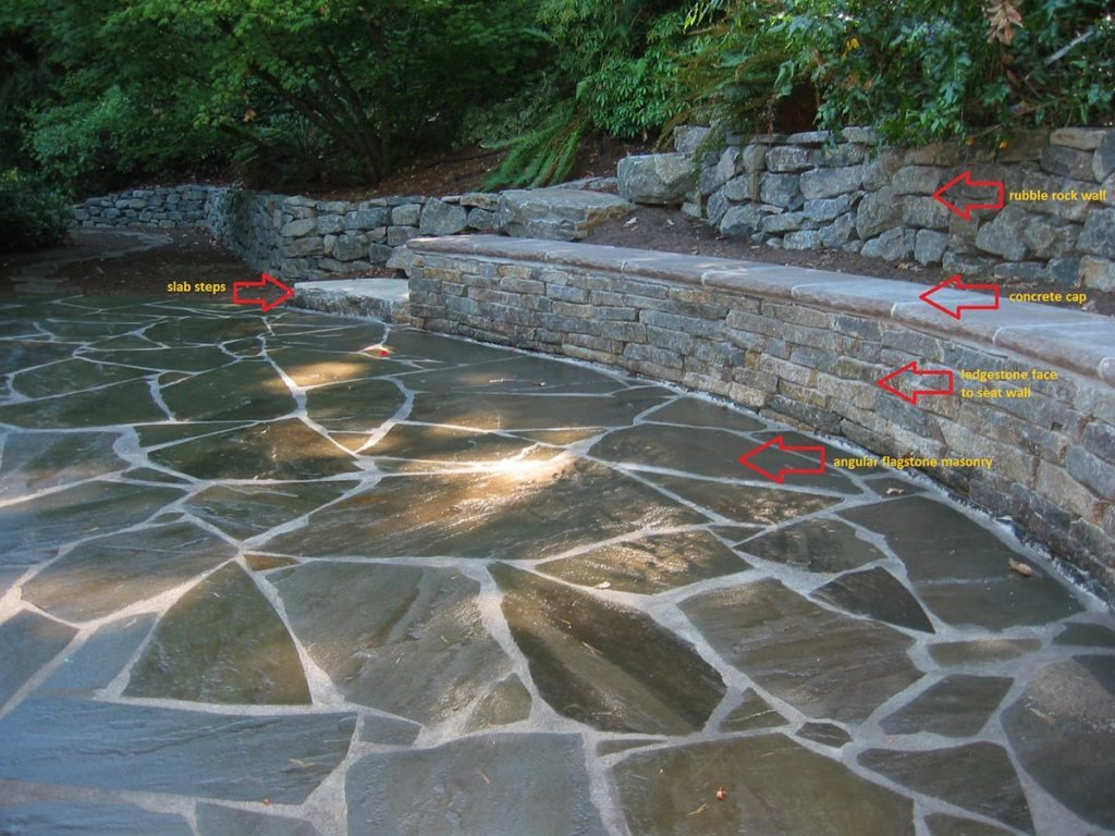 flagstone patio seat wall with ledge stone rubble wall in landscape design 2
