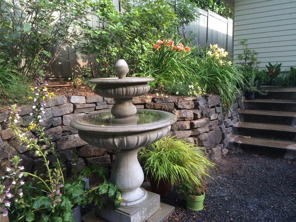 crushed gravel patio with bird bath landscape design 5