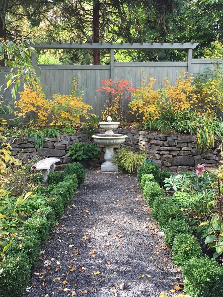 crushed gravel patio with bird bath landscape design 3