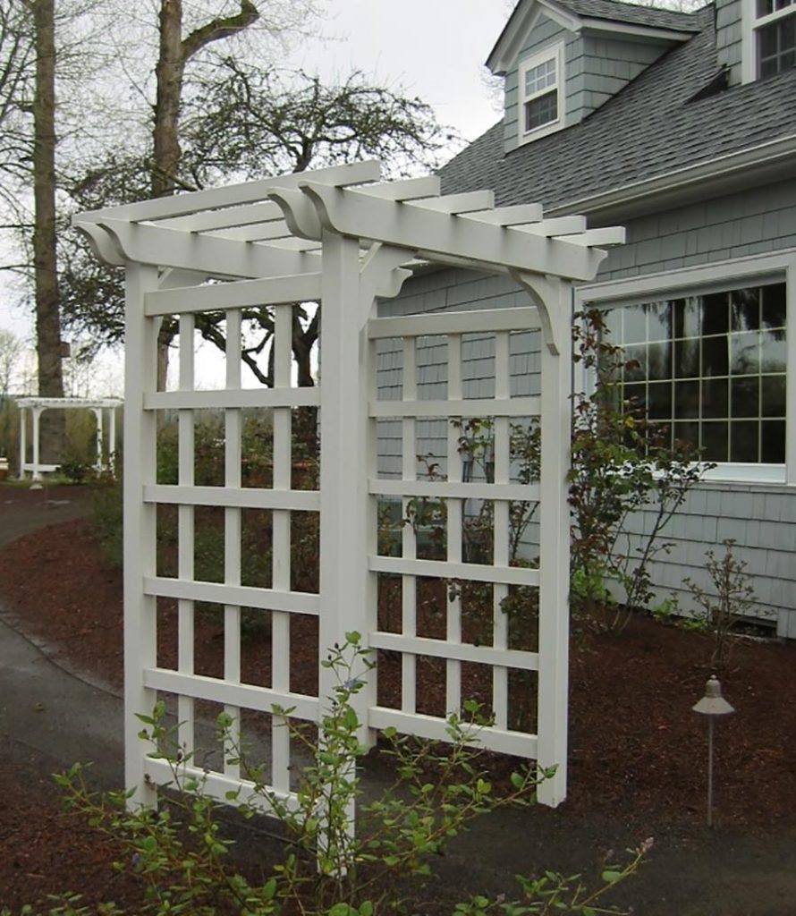 arbor with trellis sides and crushed gravel landscape