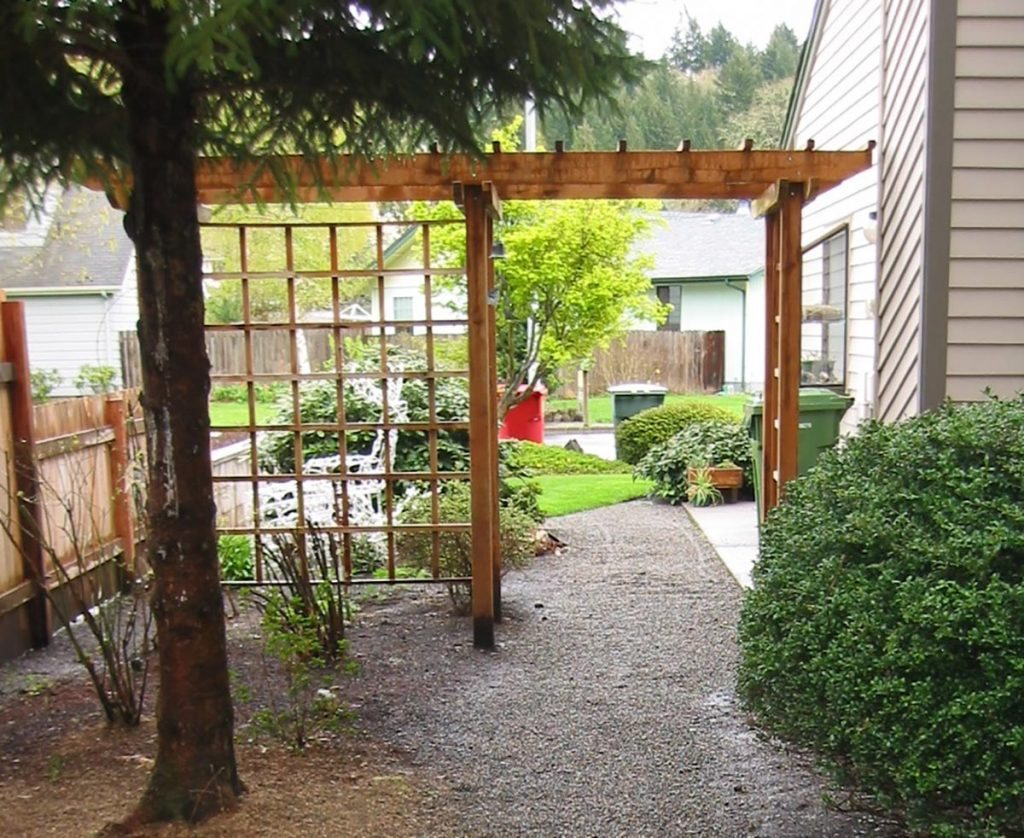 gravel path with trellis and arbor landscape design