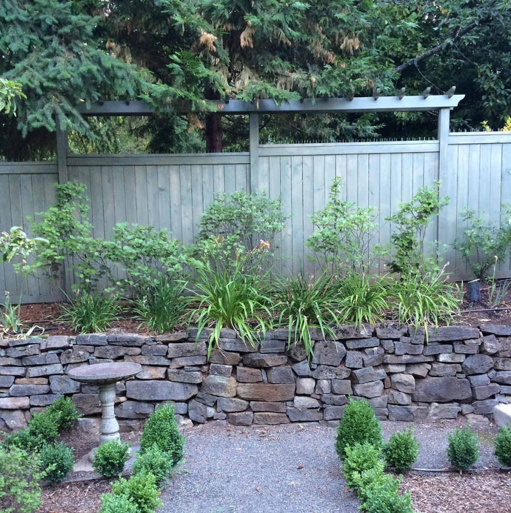 garden wall seat wall with gravel path in salem oregon