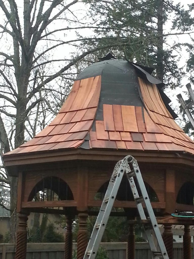 gazebo construction with cedar shake roofing in landscape salem oregon
