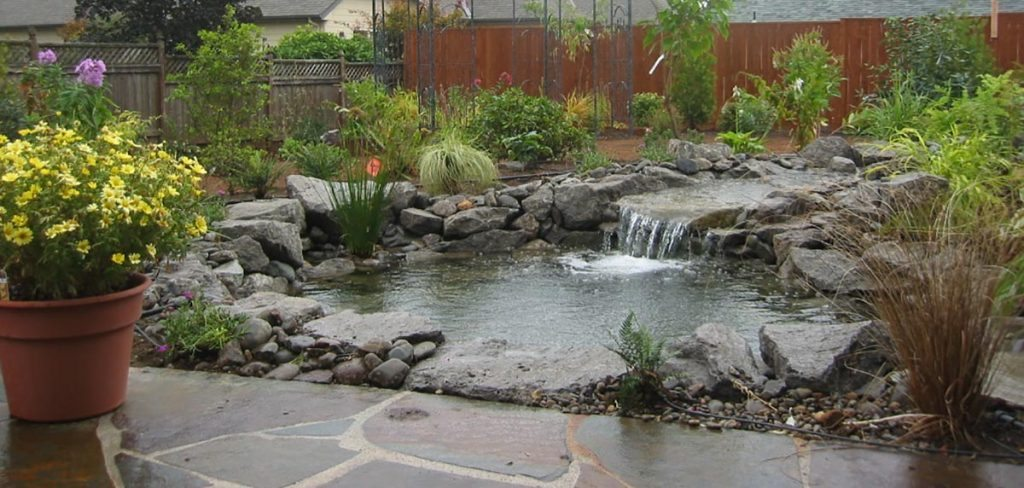 pond with waterfall and mortared flagstone patio landscape design