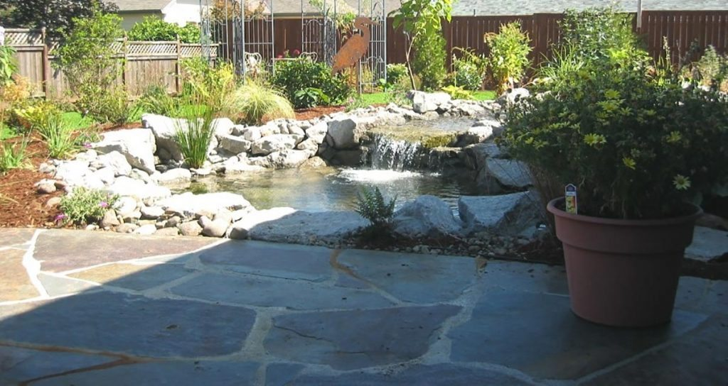 pond with waterfall and mortared flagstone patio landscape design 2