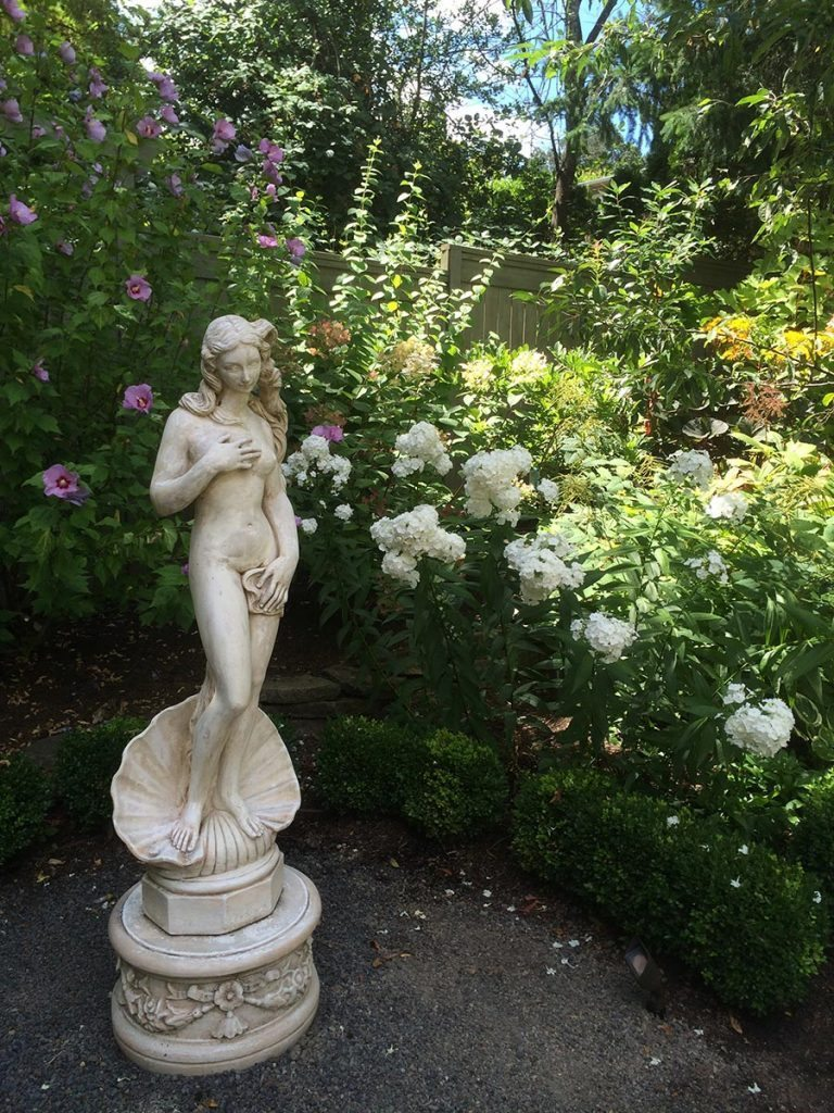 marble statuary with greenery landscape design 2