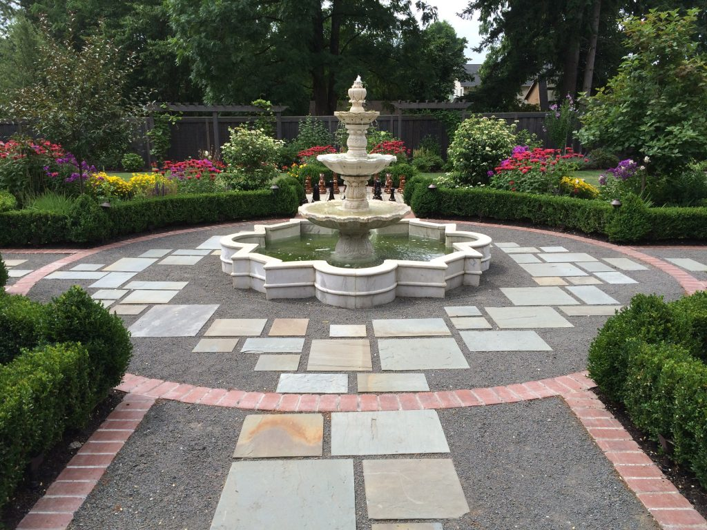 marble fountain & plantings landscape design